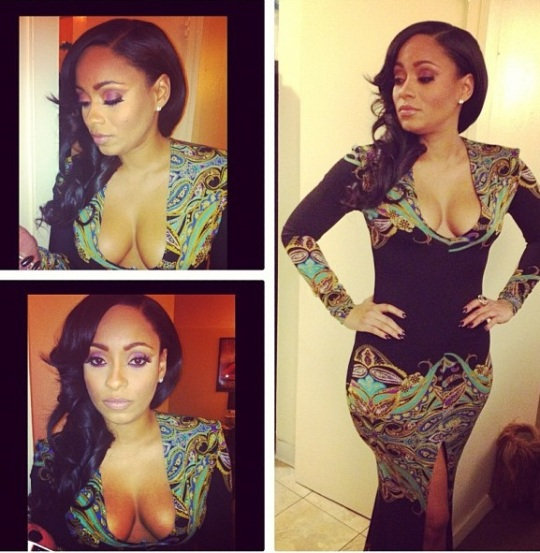Tahiry looks stunning during taping in this black floor length printed dress! Gave it edge with the high split and deep V!